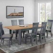 Range of dining furniture in midnight blue and oak.
